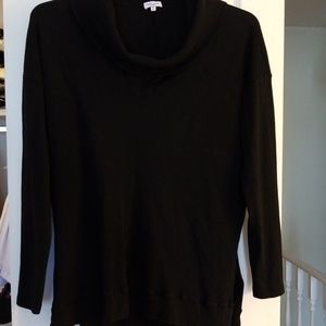Long sleeved tunic with cowl neck.